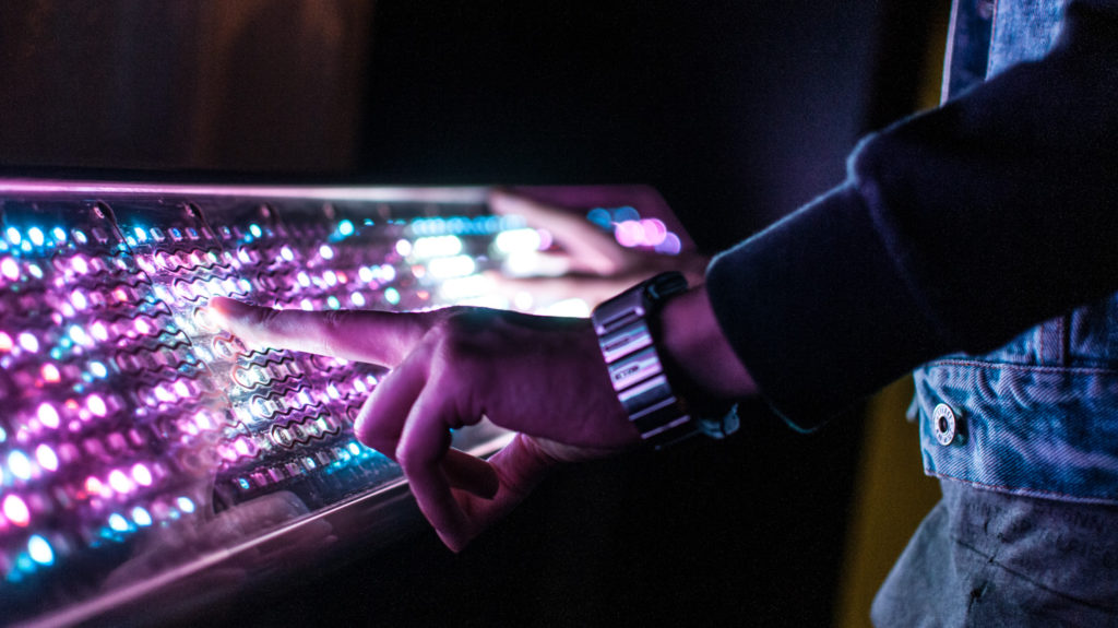 Close up of hands playing Light Synth