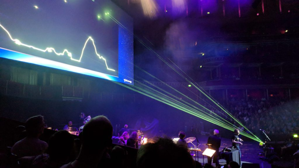 "Laser beams render the arcade game ""Lunar Lander"" onto a large screen at the Royal Albert Hall"