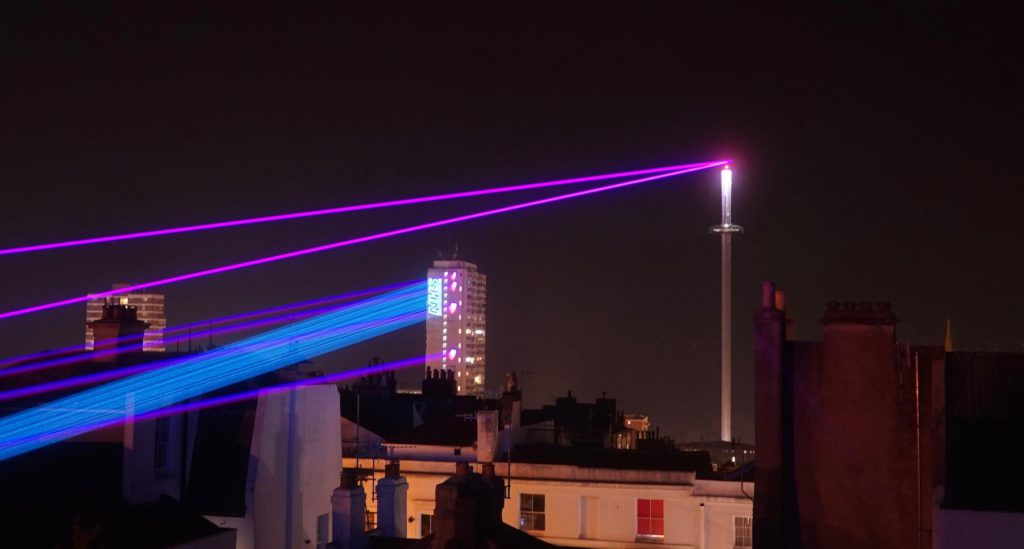 Lasers firing across the Brighton sky